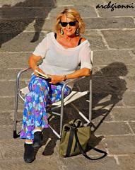 seggiola in piazza (archgionni) Tags: street portrait woman smile square donna chair strada blonde sorriso piazza sedia ritratto bionda