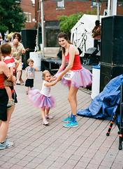 Tutu for Two (TnOlyShooter) Tags: woman film girl festival analog franklin kid dancing tennessee july4th independenceday tutu mamiya6451000s kodakektar100 franklinonthefourth mamiyasekorc80mmf28 filmboxlab