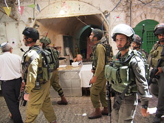 Armed Israeli forces transporting Settlers thru The old city of Hebron on a Shabbat!