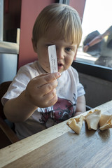 A lucky time (quinn.anya) Tags: paper restaurant berkeley toddler sam fortunecookie fortune luck lucky chineserestaurant greatchina