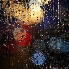 _C0A7609REWS Rainy Window I, © Jon Perry, 1-1-17 (Jon Perry - Enlightenshade) Tags: jonperry enlightenshade arranginglightcom rain rainy window raindrops drops abstract lights colouredlights coloredlights oxfordstreet london fromthebus januaryfirst firstofjanuary newyearsday newyear 1117 20170101