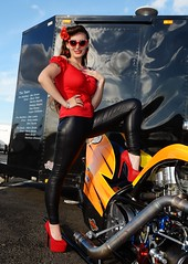 Holly_9903 (Fast an' Bulbous) Tags: supertwin nitro veetwin harleydavidson top fuel bike motorcycle biker chick babe girl woman hot sexy sunglasses long brunette hair legs red shoes high heels stilettos tight leather jeans pvc leggings model pose pinup people outdoor nikon drag santa pod england race track strip pits