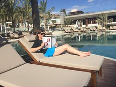 Nancy Brown Reading Hemispheres magazine (Nancy D. Brown) Tags: pool swimwear travelapparel hydrochic loscabos mexico grandvelasloscabos hemispheres nancydbrown