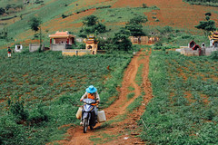 Farmer on Motorcycle, Sơn La Vietnam (AdamCohn) Tags: adamcohn bntát sơnla vietnam farmer geo:lat=21363387 geo:lon=103798489 geotagged jerrycan motorbike motorcycle wwwadamcohncom thànhphốsơnla