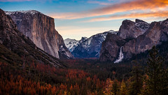 Sunrise on Yosemite Valley in Winter (Bartfett) Tags: yosemite national park california el capitan half dome bridalveil falls waterfalls sky winter sunrise dawn orange clouds mountains granite trees forest beautiful blue glow snow
