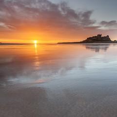 Reflecting on Bamburgh (Carl Mick) Tags: reflections sea eastcoast castle northeast sunrise ngc seascape northumberland clouds leefilters coast bamburghsunriseseascapecastle northeastcoast sand