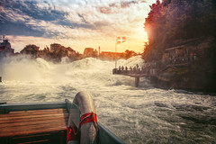 After the fall (Chrisnaton) Tags: sunset water clouds switzerland waterfall sundown lifebelt flag crowd adventure lifeboat eveningsky rhein rapid turbulence eveninglight rheinfall swissflag wildwater eveningmood eveningcolors downtheriver inasafeplace boatage