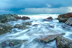 Waves crashing on rocks (mattkingx1992) Tags: ocean blue sky storm detail beach nature beautiful weather clouds island timelapse big sand rocks exposure honeymoon waves gulf natural florida vibrant stormy tropical detailed roughwaves