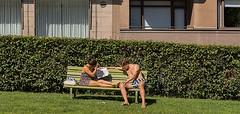 Summertime in Helsinki (Poupetta) Tags: woman man window bench helsinki balcony summertime sunbathing hesperiapark