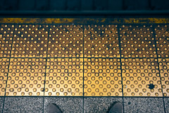 Platform shoes (Hejemoni (@fbauzonx on Instagram)) Tags: city nyc newyork color texture geometric station yellow train tile square shoes pattern pov platform bumpy
