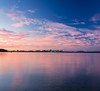 natural blush (almostsummersky) Tags: horizon madison capitol winter reflection city cityscape lake clouds lights longexposure lighttrails isthmus estherbeachpark blue pink wisconsin lakemonona sky park buildings skyline water sunset unitedstates us