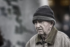 Dislikes rain (Frank Fullard) Tags: frankfullard fullard candid street portrait wet rain weather dislikes cap unhappy solemn shower dublin irish ireland