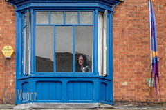 Watcher at the Window (Sue_Hutton) Tags: ashbourne june2016 streetfest watcher entertainers festival summer window