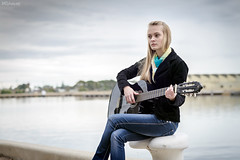 Cute blonde playing guitar while sitting on the bitt (spotandshoot.com) Tags: park sea portrait people music woman inspiration playing cute water girl beautiful beauty look modern female youth river hair fun happy photo student holding pretty european sitting natural guitar outdoor country young australia talent shade blonde instrument attractive adelaide casual leisure sa tune activity southaustralia authentic chords caucasian bitt portadelaide