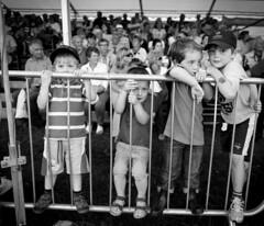 Boys at the railings (Mike Ashton) Tags: show kids rural fence countryside shropshire farm farming fair event barrier railing agriculture spectators livestock