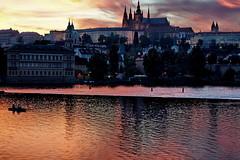The sunset over the Vltava (Yuri Rapoport) Tags: 2012 hradčany praguecastle stvituscathedral church thevltavariver night prague czechrepublic stnicholaschurchmalástrana malástrana