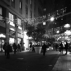 """Night Lights"" (giannipaoloziliani) Tags: christmaslights flickr streetphoto urbannight prospettiva marciapiede obscure perspective darkness buio dark streetdetails details urbanblackandwhite urbanstreets urban street streetphotography centre shops windows life sidewalks citynightlife citylife luminarie luci italia walking walks iphonephoto iphone persone monocromatico biancoenero blackandwhite monochrome genoacity city genoa people liguria genova notte italy lights nightlights night downtown"