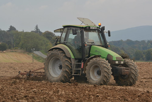 Deutz Fahr 135 Mk3 Tractor with a Tine Harrow