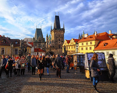 Charles Bridge in Prague, Czech Republic (` Toshio ') Tags: toshio prague czechrepublic czechia charlesbridge bridge towergate people tourists art europe european europeanunion architecture travel history fujixe2 xe2 clouds city