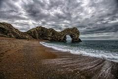 Rock of Ages (Jon_Wales) Tags: jurassic coast stone arch limstone history geology water sea seaside waves england dorset english winter durdle door