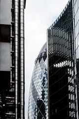 Swiss Re Gherkin Building in London's Financial District (basair) Tags: pickle londonengland 30stmaryaxe builtstructure architecture glass buildingexterior skyscraper closeup business tower contemporary normanfoster curve geographicallocations traveldestinations clearsky tourism nobody copyspace blue steel environment office city officebuilding famousplace uk england westerneurope europe editorial urbanscene towerhill downtowndistrict colorimage locallandmark internationallandmark nationallandmark officebuildings brexit lloydsoflondon finance insurance cityoflondon pipe cityscape banking airduct globalbusiness districttype futuristic chrome financialdistrict capitalcities businesstravel globalfinance metal pattern citylife skyline construction placeofwork willisbuilding metallic greaterlondon richardrodgers stainlesssteel facade