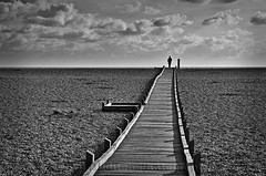 Skywalker (Dave Hilditch Photography) Tags: kent dungeness blackwhite monochrome shingle beach boardwalk sky clouds nature landscapes