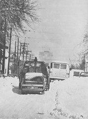 A tow truck tries to navigate snow-clogged streets. (Rocky Mountain News / Denver Public Library Archives)