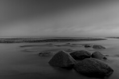 Baltic Sea - long exposure (MarcelPictures) Tags: ocean longexposure sea beach water strand outdoors blackwhite wasser stones dramatic wolken baltic menschen steine filter nd ghosts holz chill cluds humans steg langzeitbelichtung ruhig dahme heister schwarzweis dramatisch chillig ostesee drausen rosenfelder
