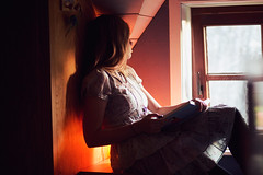 The storyteller (Tinekedw) Tags: light summer portrait orange selfportrait cute window girl yellow reading book warm dress warmth books read blonde windowlight