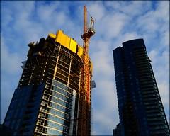 The New Seattle (@GilAegerter / klahini.com) Tags: nikon nikkor 28mmf28ais manualfocus manuallens seattle urbanlandscape skyscrapers buildings architecture sky clouds construction constructioncranes pixel