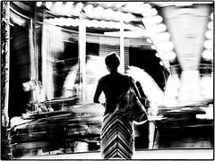 Manège fou. (mildiou2) Tags: manège carrousel fête woman light night black white bag dress street france