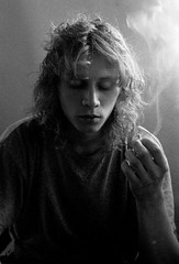 lumière et fumée (asketoner) Tags: paris portrait man smoking cigarette smoke light daylight france long hair
