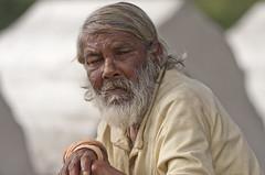 Man on Kandy riverside (David Rosen Photography) Tags: people portrait poverty sri lanka asia street man kandy travel canon200ml28primelens