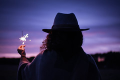 Looking for magic (the_wonderer_wanderer) Tags: magic portrait sunset girl sparkle purple hat light magical sky travel