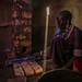 Teresia Oloitai gets a clean stove at her home in a Maasai boma in Tanzania