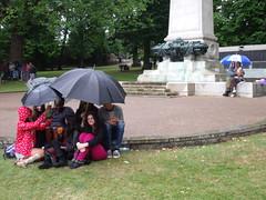 Good old British summertime (gryphon569) Tags: rain umbrellas warmemorial