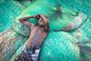 Camera-shy (Vinith GR) Tags: vinithgrphotography childrenofindia tamilnadu india indiaasweseeit southindia lifeinindia fishermen coastal sea environmetalportrait people soulful shy boy net colorsofindia sonya6000 sony1018mm dhanushkodi vinithgr