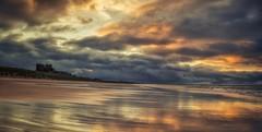 Shining Beach (Captain Nikon) Tags: bamburghcastle beach bamburgh northumberland northeast northern coast coastal moody panoramic pano stitched sunset stormy castle nikond7000 nikon18105mmf35