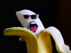 Sun bathing Banana (Joan's Pics 2012) Tags: sunbathingbanana macromonday fruit skin yellow shocked annoyed 117picturesin2017 01somethingyouopen