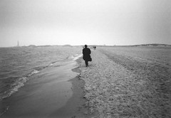 Bleak Beach Scene (Linus Wrn) Tags: ocean blackandwhite bw lighthouse beach water monochrome denmark blackwhite europe waves windy skagen