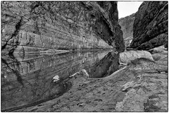 The Rio Grande (Zoo Much Information) Tags: rock was winter river canyon water bigbend bw monolith reflection nationalpark riogrande texas mexico blackwhite