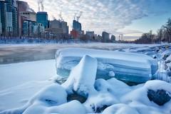 Ice Blocks Calgary (John Andersen (JPAndersen images)) Tags: 12monthsofthesameimage 2017 bowriver calgary centrestreetbridge city cold ice january skyline towers winter