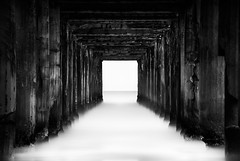 Gesell's Pier (hzeta) Tags: villa gesell long exposure pier muelle exposicion larga black white blanco y negro water sea agua mar oceano ocean columns columnas perspective perspectiva sequence secuencia