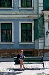 Gonna break my face on the sweet sunshine (Massimo Usai) Tags: baltic capital europe latvia riga travel people woman reading relax cityscape life town blue sunshine