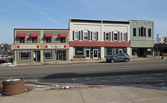 Buildings — Hillsdale, Michigan (Pythaglio) Tags: buildings structures commercial historic remodeled altered twostory hillsdale michigan county storefronts windows 11 segmentalarched cornice signs awnings car automobile street sidewalk sky blue