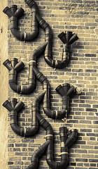 YouTubes of Bygone Era... (Aditya Falodiya) Tags: seattle white black brick wall port tubes aditya era bygone youtubes falodiya adityafalodiyaphotography