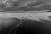Crawling on four (www.guygevaart.com) Tags: carlzeiss zeiss milvus1828 monochrome blackandwhite sea water waves light sun sunset sky weather winter wind clouds cold city landscape longexposure travel nature nikon800e
