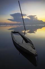 Sunken (Landscape Junkie) Tags: clouds sunrise reflections boat pole abandon malaysia sunken perahu refleksi sampan kelantan sigma1020mm tumpat lefttorot leefilters nikond90 jubakar landscapejunkie muhamadfaisalibrahim
