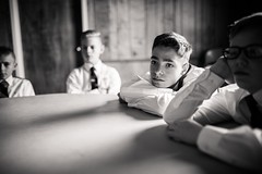 The meeting. (aamith) Tags: blackandwhite monochrome kids portrait 35mm meeting boys scouts bored bokeh dof portraiture