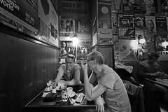 conversation (heinzkren) Tags: diskussion discussion unterhaltung plauderei conversation kaffeehaus cafe coffeehouse typisch typical characteristic raucherabteil raucher smoker raucherzone smokingsection kaffeealtwien bw blackandwhite panasonic olympus weitwinkel gespräch männer men plakate ambiente ambiance bäckerstrase beisl nachtcafe wien vienna austria poster stimmung friends freunde personen people leisuretime freizeit bar kneipe restaurant pub bnw